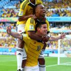 James Rodriguez of Colombia (bottom) celebrates scoring his teams third goal against Greece with Juan Guillermo Cuadrado (top) and Juan Camilo Zuniga (middle) at Estadio Mineirao on June 14.