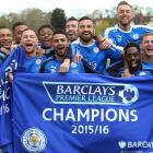 Leicester City players hold up the banner that says it all: The Foxes are Premier League champions.
