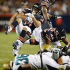 Joe Young of the Jaguars upends Eric Weems of the Bears on a punt return.