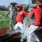 Denard Span is doused by teammates Drew Storen and Tyler Clippard after driving in the game-winning run in the ninth inning of the Nationals 3-2 win over the Cardinals.