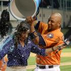 Reporter Leila Rahimi is doused by the Carlos Corporan following the Astros 5-4 win over the Mariners in 11 innings.