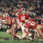 As the Cincinnati Bengals defensive line trudges through the mud to get to him, Joe Montana reaches back to pass. The San Francisco 49ers quarterback threw for 357 yards and two touchdowns, including a game-winning throw to John Taylor with 34 seconds remaining to cap off a 92-yard drive and a 20-16 win.