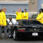 Security guards surround the car of Michael Jordan as he arrives at Chicago Stadium.