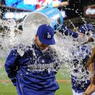 Clint Robinson is doused by teammate Drew Butera after the Dodgers 1-0 win over the Indians.  Robinson got his first major league hit, an RBI single in the bottom of the seventh inning.