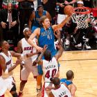 "Dirk Nowitzki avoids traffic to drop in the game-winner for Dallas in Game 2. Nowitzki's clutch shot capped a furious 15-point fourth-quarter Mavs comeback. Dallas would knock off favored Miami and the ""Big Three"" of LeBron James, Dwyane Wade and Chris Bosh in six games in a rematch of the 2006 Finals."