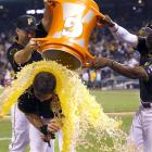 Ike Davis is doused by teammates Gaby Sanchez and Andrew McCutchen after he drove in the game winning run on a pinch-hit single in the bottom of the ninth inning of the Pirates 3-2 win over the Diamondbacks.