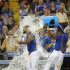 Matt Kemp is doused by teammate Yasiel Puig after hitting the game-winning RBI single in the 10th inning of the Dodgers 3-2 win over the Braves.
