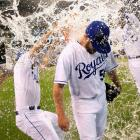 Greg Holland is doused by teammates Danny Duffy and Salvador Perez after recording his 100th career save in the Royals 4-2 win over the Giants.