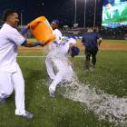 James Shields is doused by teammates Salvador Perez and Jarrod Dyson after throwing a complete game shutout in the Royals 5-0 win over the Giants.