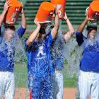 The Chicago Cubs douse themselves as part of the ALS Ice Bucket Challenge before their game against the Brewers.