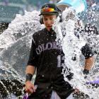 Drew Stubbs is doused after hitting a walk-off, three-run home run in the ninth inning of the Rockies 10-9 win over the Reds.