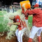Scott Hairston is doused by teammates after driving in the game-winning run in the 11th inning of the Nationals 6-5 win over the Pirates.