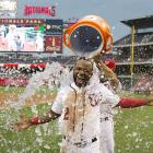 Denard Span is doused by teammate Anthony Rendon after scoring the winning run on a throwing error in the Nationals 1-0 win over the Diamondbacks.