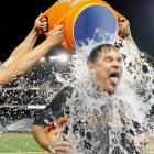 Bruce Bochy is doused as part of the ALS Ice Bucket Challenge after the Giants 10-3 win over the Nationals.