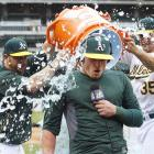 Josh Donaldson is doused by teammates after his game-winning two-run home run in the 10th inning of the A's 8-6 win over the Phillies.