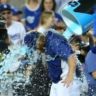 Justin Turner is doused by a teammate after hitting two home runs in the Dodgers 4-2 win over the Giants.