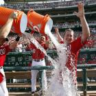 Jordan Zimmermann is doused by teammates after pitching a no-hitter in the Nationals 1-0 win over the Marlins.  It was the team's first no-no since moving to Washington from Montreal.
