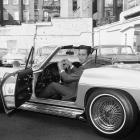 Los Angeles Dodgers pitcher Sandy Koufax posing in the driver seat of his sports car, which was given to him by a magazine. The award was for the outstanding work on the mound Koufax did in the 1965 World Series. He pitched two wins that led the Dodgers to take the Series 4-3 over the Twins.