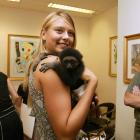 Sharapova isn't too shy to hold the monkey, embrace her new fame and smile for the cameras backstage.
