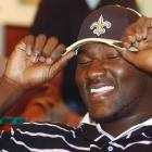 Oklahoma offensive tackle Jammal Brown tries on a New Orleans Saints hat after the Saints selected him 14th in the 2005 draft.