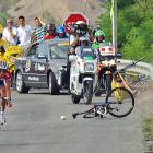 Verbrugghe again, this mishap coming four years later, during Stage 14 of the '06 Tour. The rider sitting on the pavement is the Spaniard David Canada. Verbrugghe, having flown over the guardrail and into a ditch, is not pictured. Both riders abandoned the Tour that day.