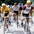 Dutchman Joop Zoetemelk, wearing the leader's yellow jersey, rides uphill next to Frenchman Raymond Martin during the 17th stage of the Tour de France between Serre-Chevalier and Morzine on July 14, 1980. Zoetemelk finished 13th of the stage won by Frenchman Mariano Martinez but went on to win his first and only Tour de France in Paris.