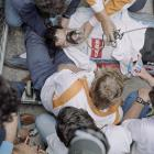 French cyclist Stephen Roche is rescued after fainting, on July 22, 1987 at the arrival of the 21st stage of the Tour de France between Bourg d'Oisans and La Plagne.