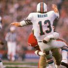 Miami Dolphins quarterback Dan Marino absorbs a big hit from San Francisco 49ers defensive tackle Gary Johnson. Marino completed 29 of 50 passes for 318 yards and a touchdown but his Dolphins fell 38-16.
