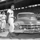 Ted Williams smiles as he is presented with a new car during a pre-game ceremony at Fenway Park in 1952.  Williams went on to hit a game-winning home run that day, as his Red Sox grabbed a 5-3 victory over Detroit.