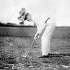 Woodrow Wilson, the 28th President of the United States, plays golf in 1916.