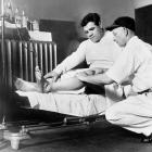 Babe Ruth gets his knee checked out by Dr. Woods in Oct. 1928.