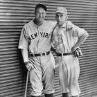 Seen here with Bobby Lowe, the first player to hit four homers in a game, Gehrig almost had five home runs in the New York Yankees' 20-13 win over the Philadelphia A's. His 450-plus foot shot to center field of Shibe Park was nabbed by Al Simmons in his last at-bat. He went 4-for-6.