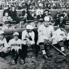 Babe Ruth posing with bat boys during a barnstorming tour of Japan.