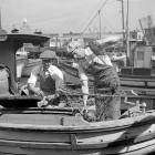 Joe DiMaggio pays a visit to the family fishing boat shortly after his return to San Francisco on Oct. 14, 1936.  With him is his brother, Mike.