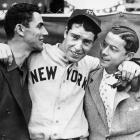 Joe DiMaggio hugs his brothers Vince (left) and Dom before the start of the 1936 World Series in New York.