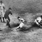 Joe DiMaggio slides home safely for the go-ahead run in the ninth inning of the Yankees 7-4 win over the Dodgers in Game 4 of the 1941 World Series.