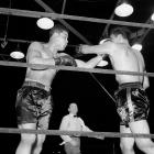 Though at 6-6 he had a few inches on his brother, Buddy Baer was not the fighter Max was. Still, he gave Louis trouble for the first six rounds of their bout at Griffith Stadium in Washington, D.C., before Louis caught up to him. Baer survived the round, but was disqualified by referee Arthur Donovan for stalling at the bell for the next round. The two would meet again in a rematch in January 1942. That time Louis ended it in one round.