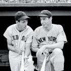 Ted Williams chats with Yankees star Joe DiMaggio before a game in 1942.