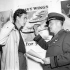 Ted Williams, enlisted in the U.S. Navy, reenacts the oath-taking ceremony with Lt. Frank S. Donahue in 1942.