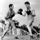 Ted Williams trades punches with boxing coach Lt. Alfred Woff at the Navy Pre-Flight school in 1943.