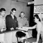 Sergeant Joe DiMaggio, back from the Pacific where he served with the 7th US Army Air Force, checks in at the AAF Don Ce-Sar Hospital near St. Petersberg, Fla., for stomach disorder treatment.