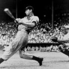Joe DiMaggio follows through with a swing during a game in 1946.