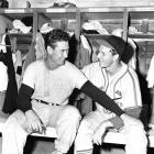 St. Louis Cardinals star Stan Musial and Ted Williams, the reigning NL and AL MVPs, joke around before an exhibition game in 1946.