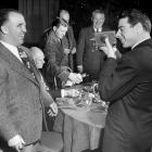 Joe DiMaggio takes a photo of Albert B. Hoppy Chandler at the Banquet of Sports Champions in 1948.