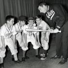 Joe DiMaggio conducts a batting clinic for a group of youngsters in 1951.