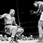 """Call this Exhibit A for the old boxing adage that it never ends pretty. Fighting on only for the money, Louis beat a series of lesser fighters before signing to face undefeated up-and-comer Rocky Marciano. The crude but brutally strong and powerful Marciano reportedly hated the thought of having to fight his aging hero, but when the moment came in Madison Square Garden, he didn't hold back. Marciano battered Louis throughout, finally knocking him through the ropes to end it in the eighth round. Red Smith's column on the fight ended with this memorable paragraph: """"An old man's dream ended. A young man's vision of the future opened wide. Young men have visions, old men have dreams. But the place for old men to dream is beside the fire."""""""