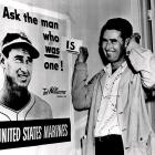 Ted Williams poses next to a U.S. Marines recruitment poster in 1952. Williams was called back into active service that year.