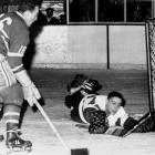 """Diminutive winger Tony """"Mighty Mouse"""" Leswick (inset) ended a defensive struggle with a goal at 4:29 of OT to give Detroit the Cup. Goalies Terry Sawchuk (Detroit) and Gerry McNeil (Montreal) seemed locked in until Leswick floated a shot that glanced off Canadiens defenseman Doug Harvey's glove and into the net. The match remains the last Game 7 to decide the championship in OT."""