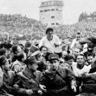 """German captain Fritz Walter and coach Sepp Herberger are hoisted on the shoulders of their compatriots after West Germany beat the heavily favored Hungarian team in the 1954 World Cup final, 3-2, nicknamed """"The Miracle of Bern."""""""