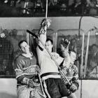 Montreal's Butch Bouchard (left) and Floyd Curry managed to slow Gordie Howe during this moment in Game 7, but the Canadiens were barely able to stop him during the series. Mr. Hockey was on a tear in that final, scoring an NHL record 12 points, including the goal that gave the Wings their fourth Cup in six seasons.